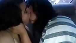 Lesbian girlfriend kiss in the car